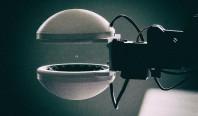 Представлен робот, который поднимает предметы, не прикасаясь к ним